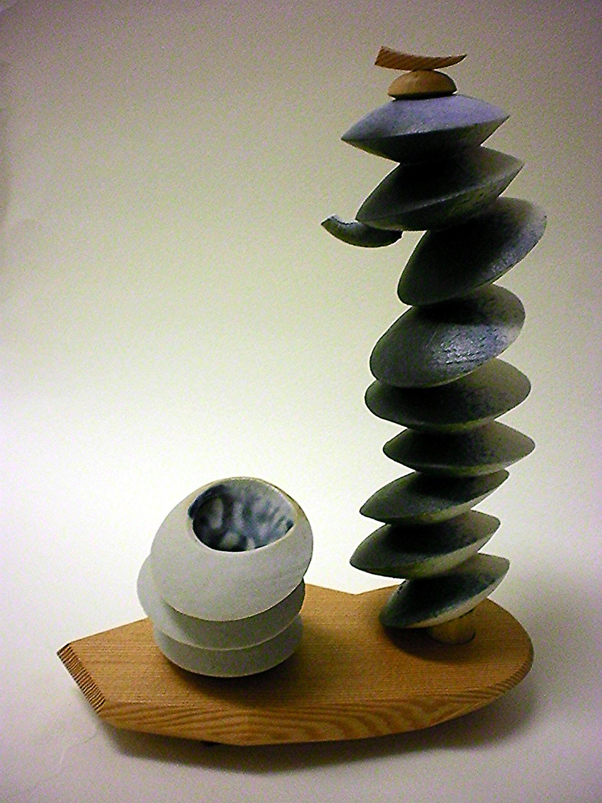 "Turning Clay Tea-pot , 2008   6"" x 10"" x 4""  Cone 10 Porcelain, Douglas Fir, Ash Glaze"