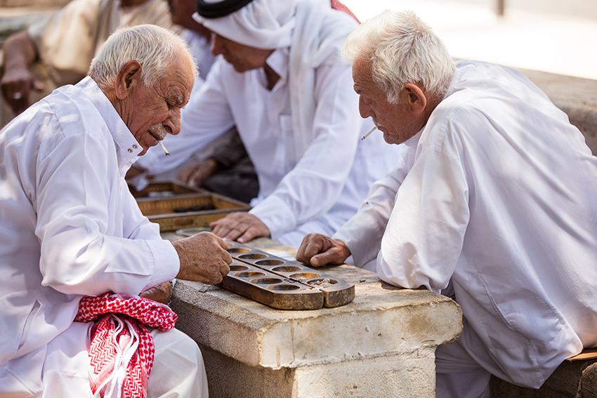 These gentlemen meet in the square daily to chat, play games and smoke their cigarettes