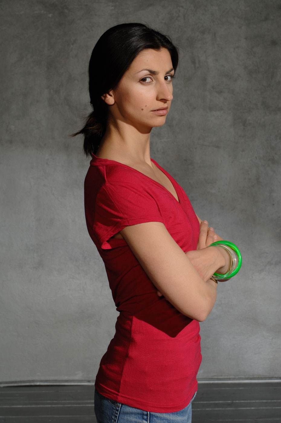 Portrait of a dark-haired girl in a red shirt