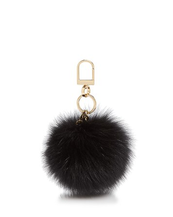 One of these furry little bag charms.  $95 at  tory burch