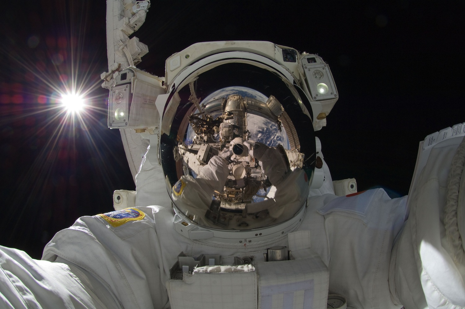 Sensors, like those in this space suit, will one day include brain and behavioral measures. Image by NASA.