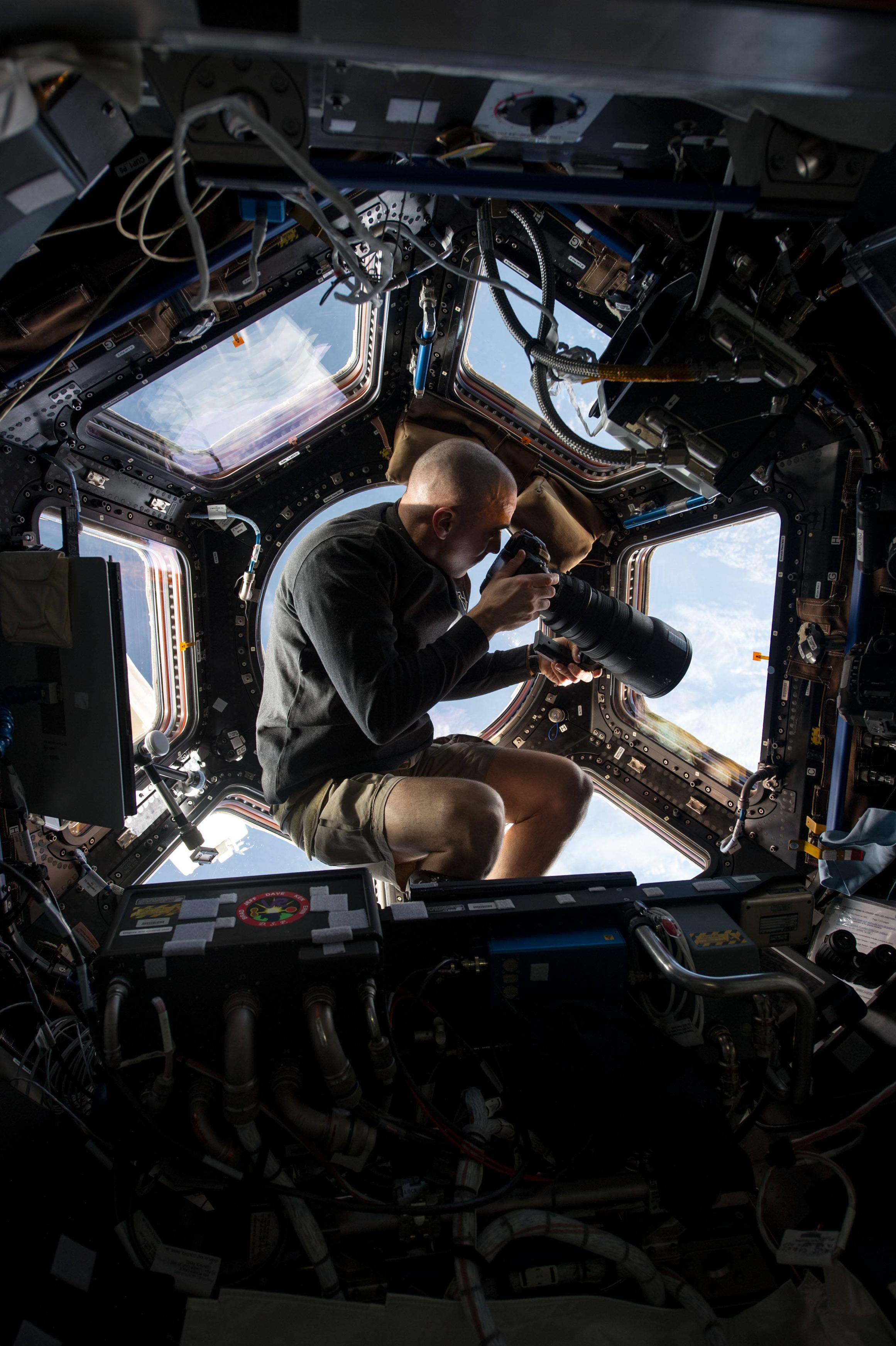 NASA astronaut Chris Cassidy taking a photo from the ISS's cupola viewport. Image by NASA.