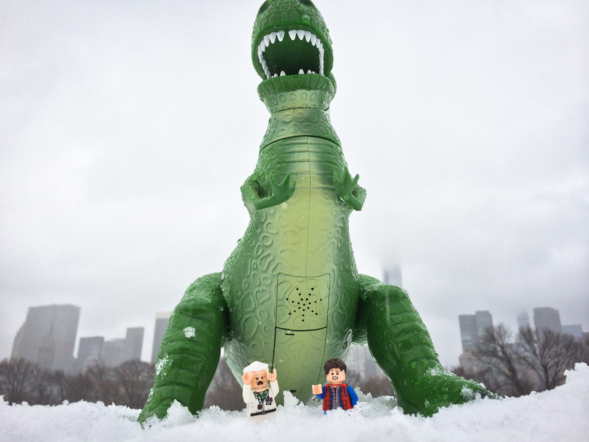 Back to the Future lego Marty McFly and Dr. Emmett Brown with Toy Story Rex in New York City snow.