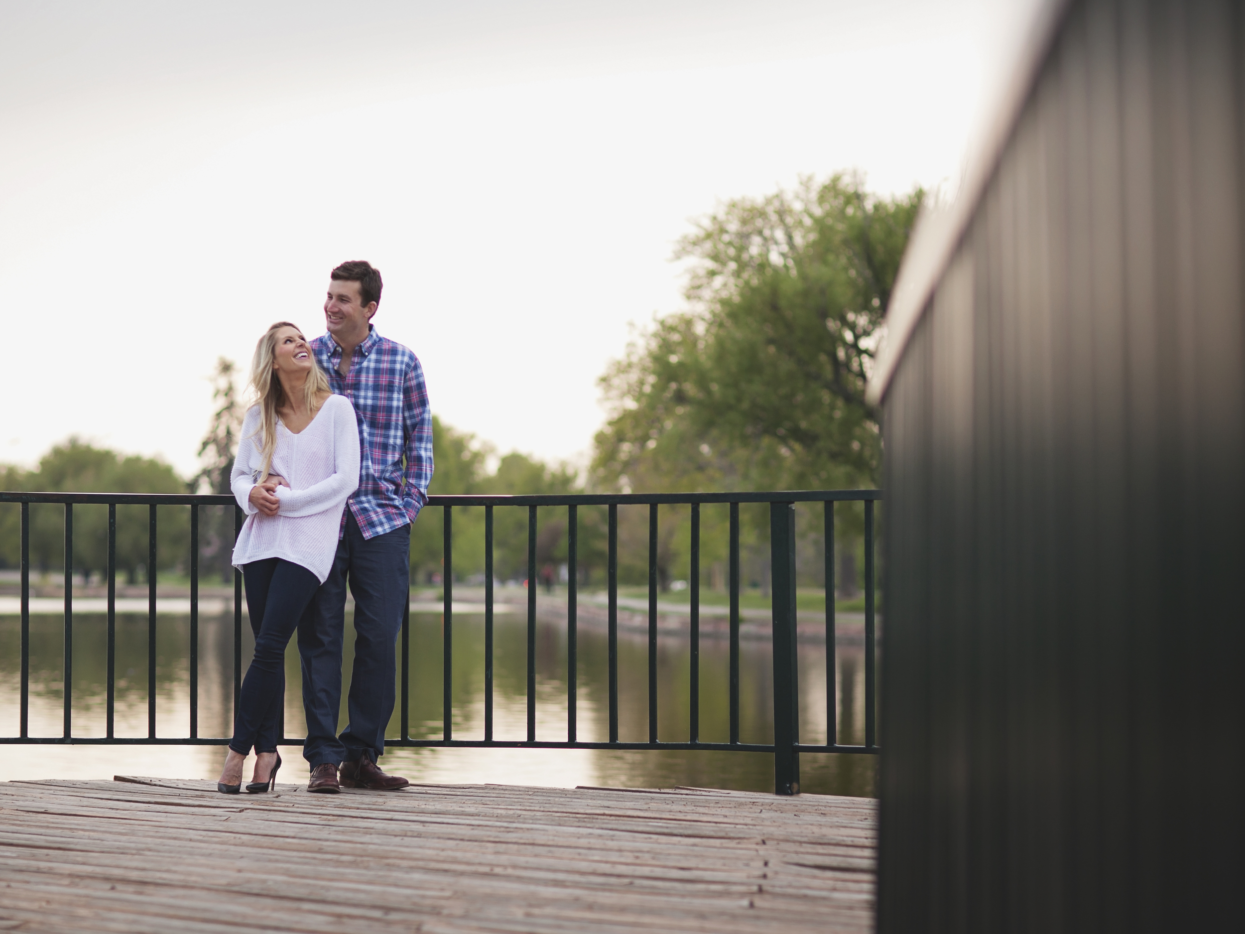 Couple standing on deck at City Park in Denver, Colorado