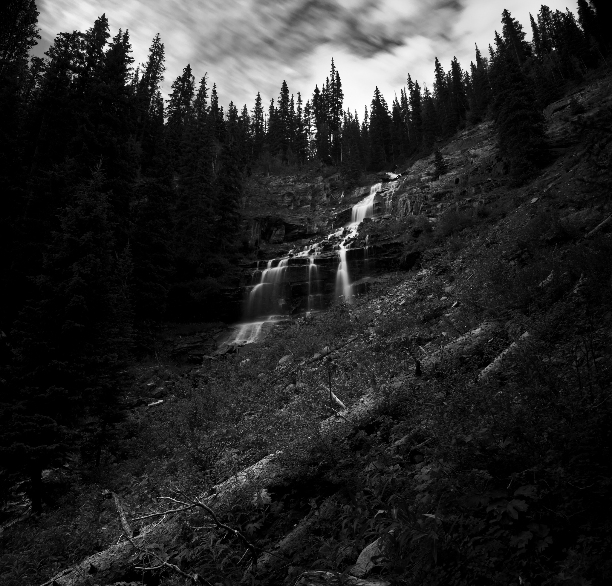 Random waterfall on the way up to Ice Lakes in Colorado shot at f stop 22 with an ND filter to extend the exposure to 8 seconds
