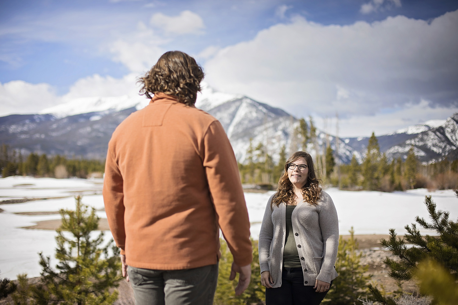 Couple facing each other with Dillon Reservoir in background