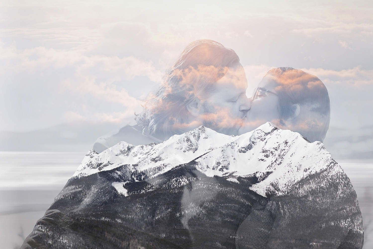 Double exposure of kissing engaged couple and the mountains