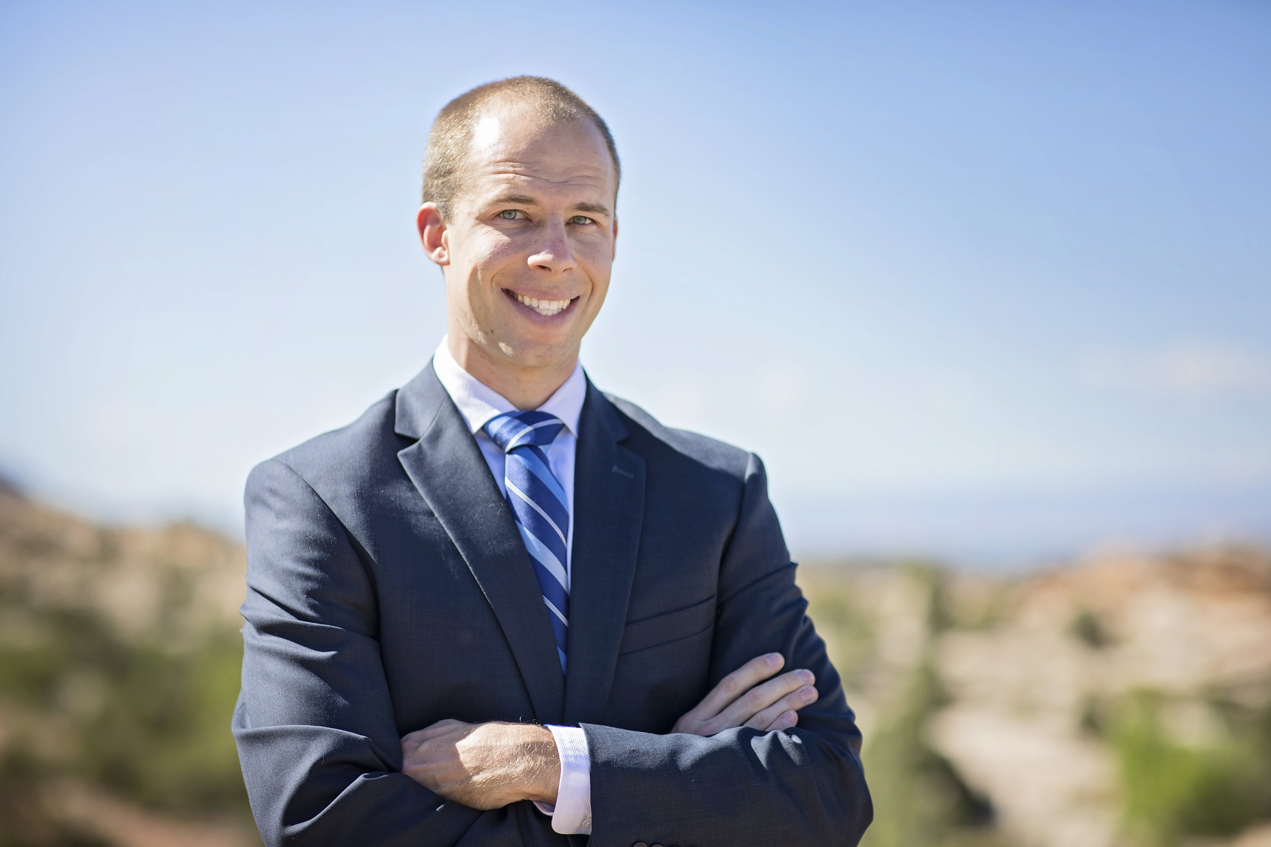 Financial adviser headshot with Grand Junction behind