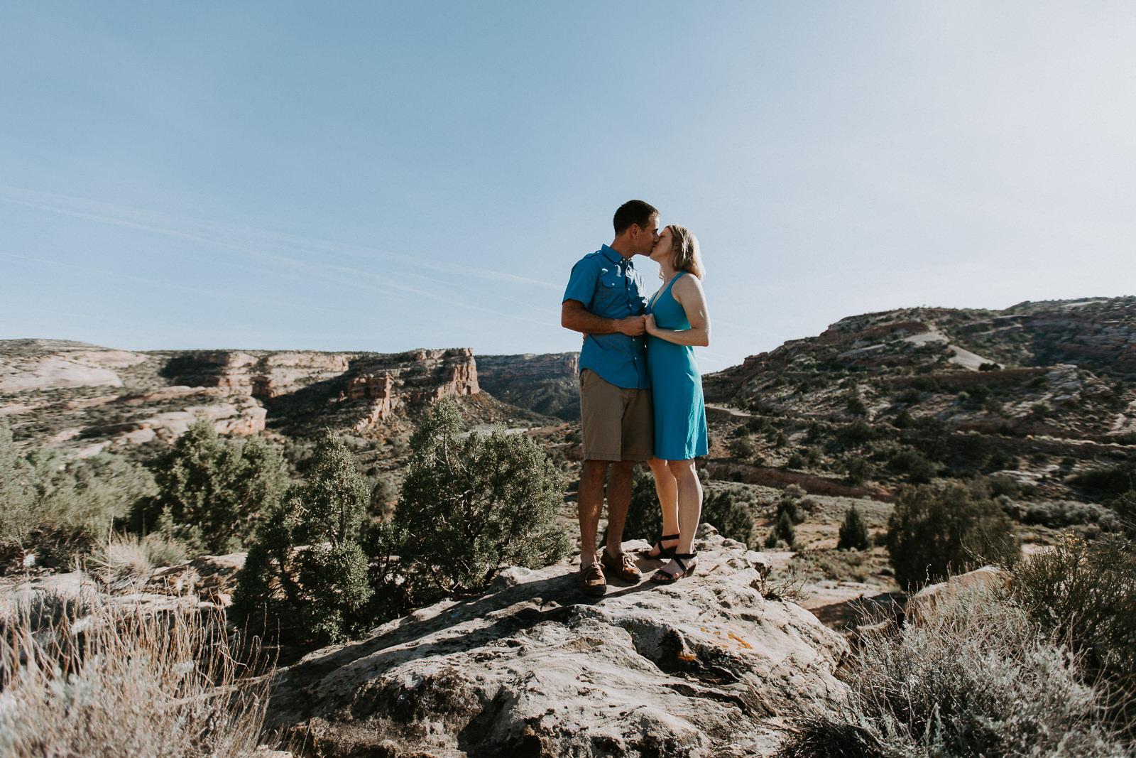 Couple kissing in the desert just outside Grand Junction