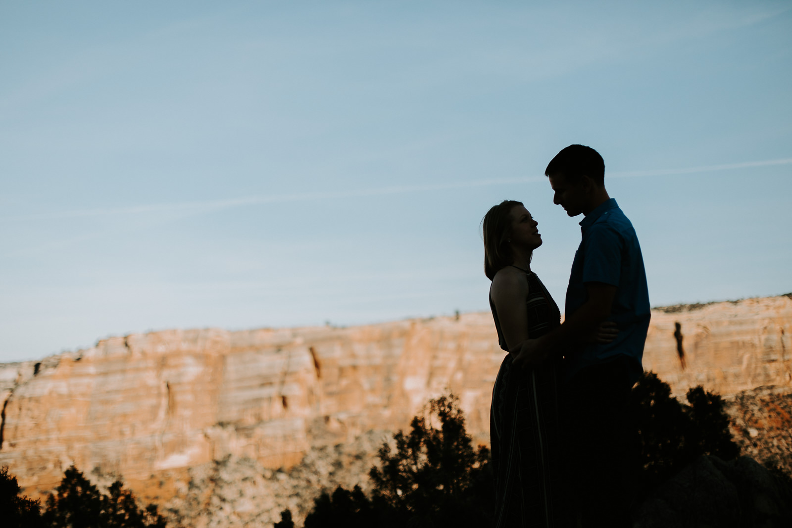 Silhouette of engaged couple with the backdrop of red rocks in Grand Junction, CO
