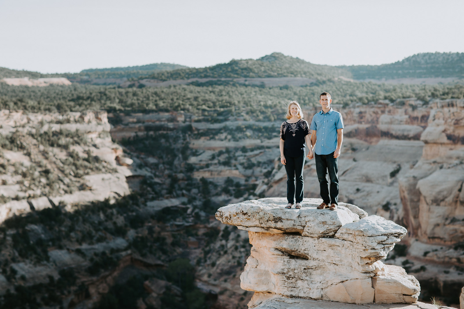 Engaged couple stand holding hands in Colorado national monument