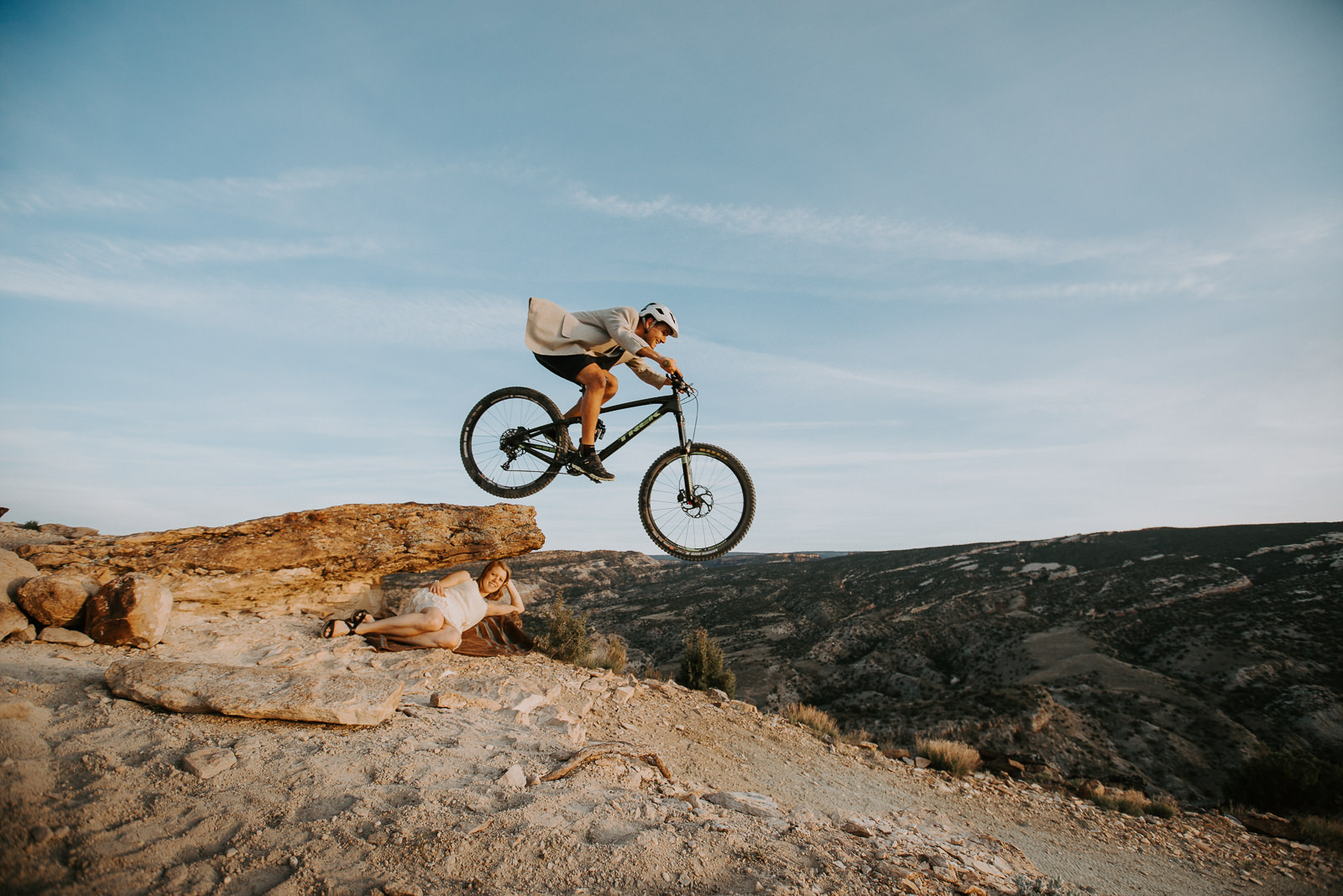 Man jumps his bike off a rock over his fiancée in the Lunch Loop Trails in Grand Junction