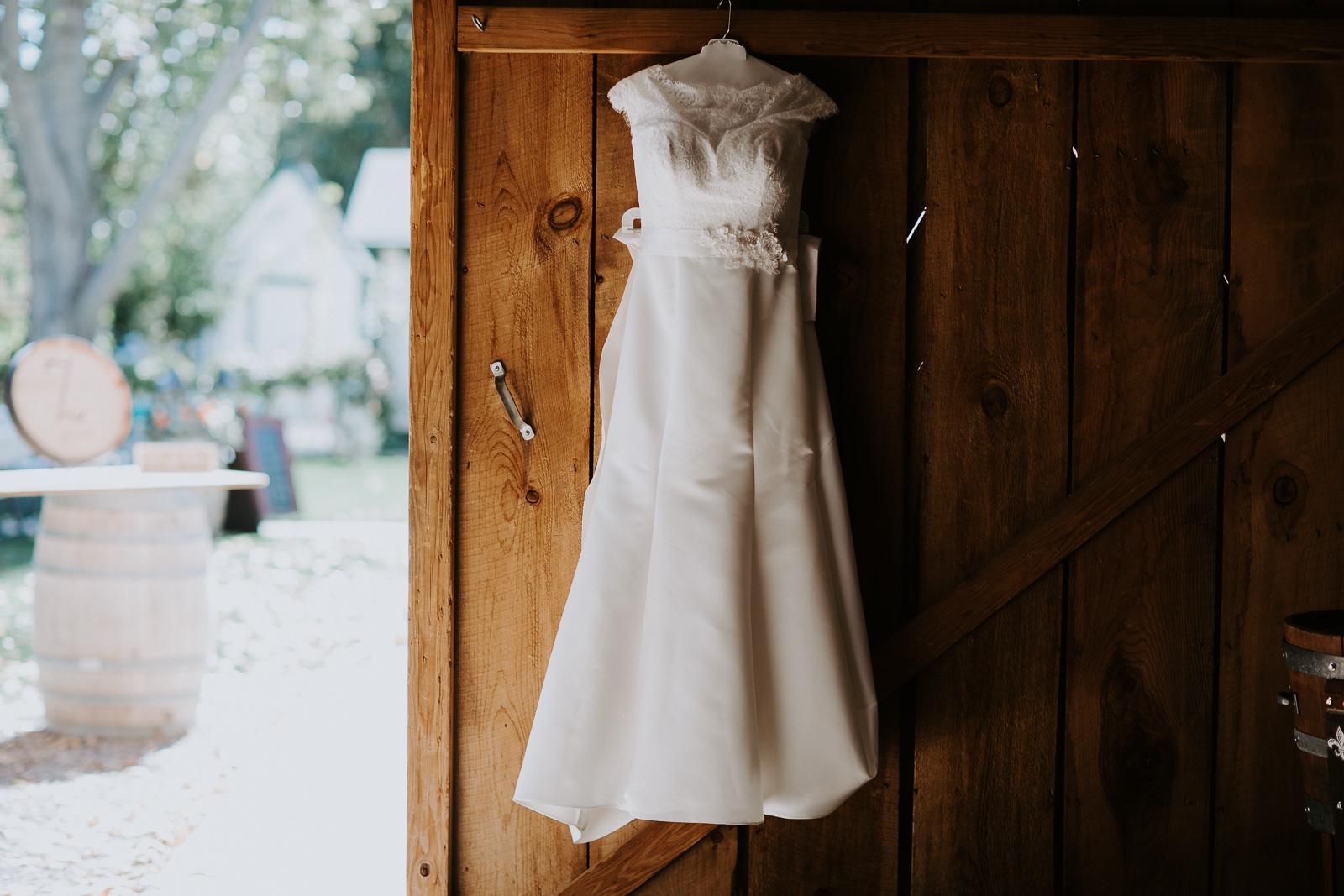 wedding dress wedding details winery barrels shoes flowers signs Palisade Colorado