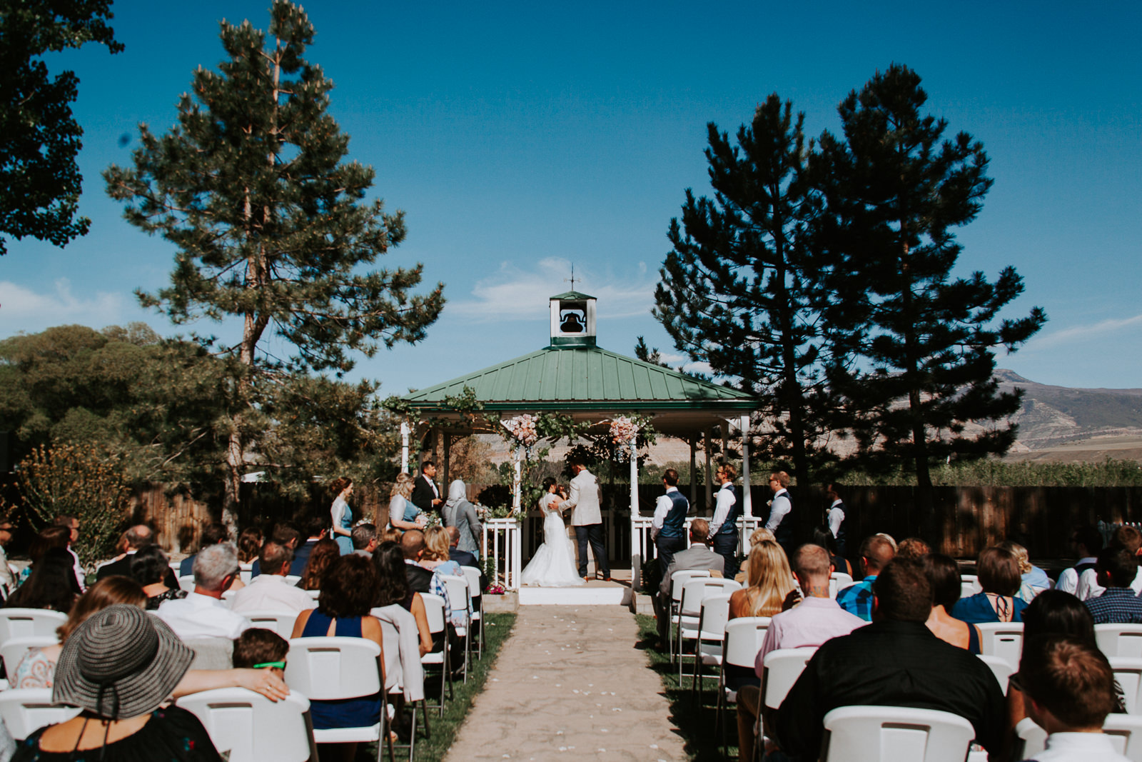 Wide view of wedding ceremony at Amy's Courtyard in Palisade, Colorado