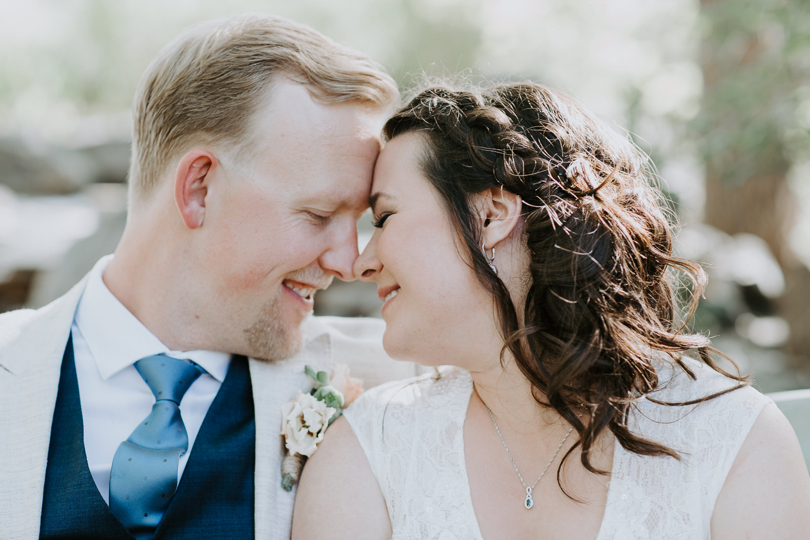 Close up of married couple nose to nose on wedding day