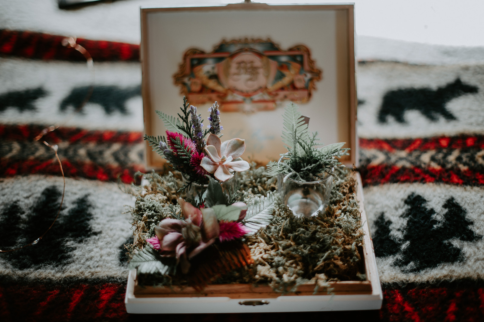 Boutonnières in a cigar box with shot glasses