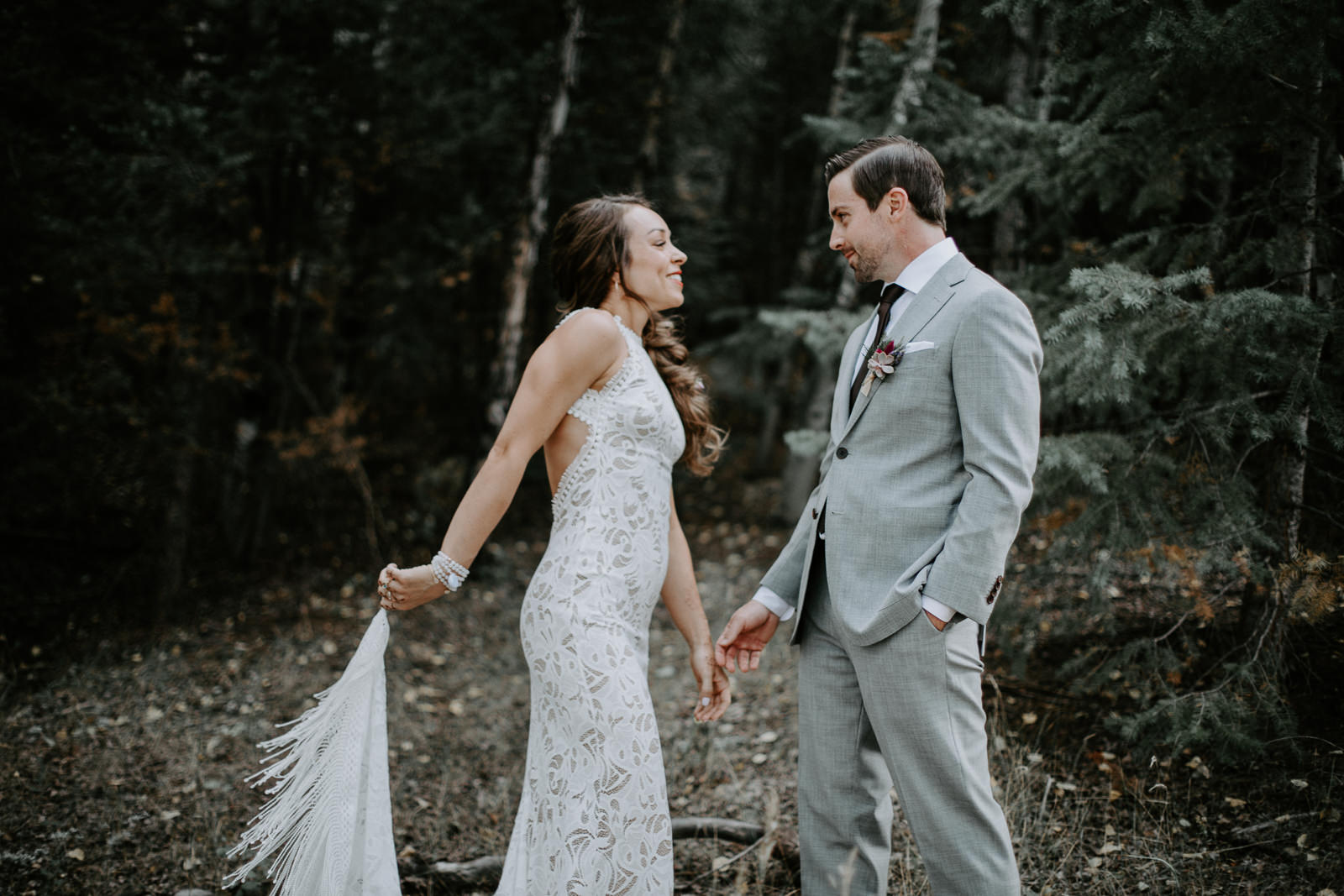 Smiling bridal couple seeing each other for the first time during a private moment together