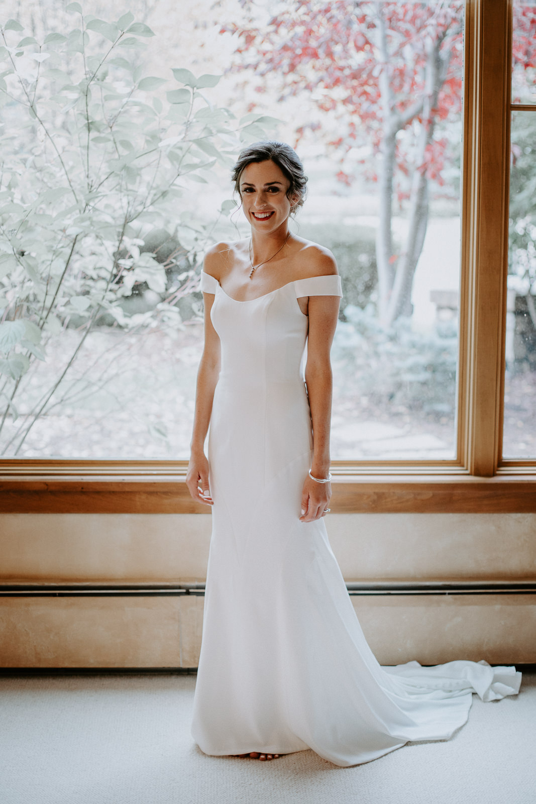 Full body portrait of bride in minimal and classy wedding dress