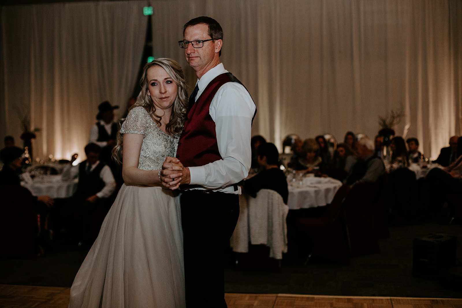 Bride crying while dancing with her dad at Two Rivers Convention Center