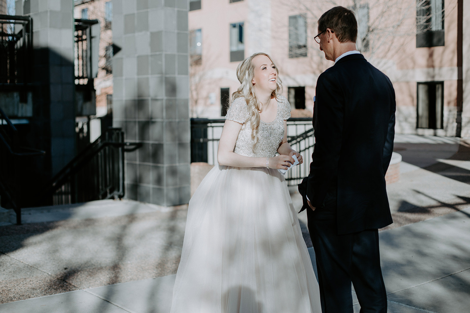 Bride tears up after seeing her dad for the first time in her dress