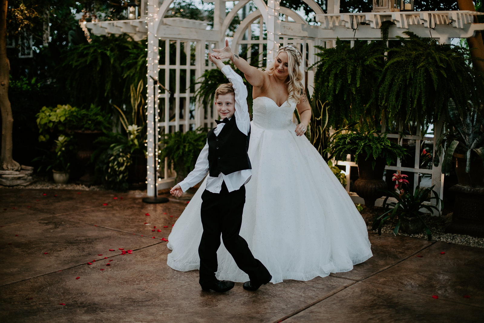 Bride twirling her son dancing during wedding reception