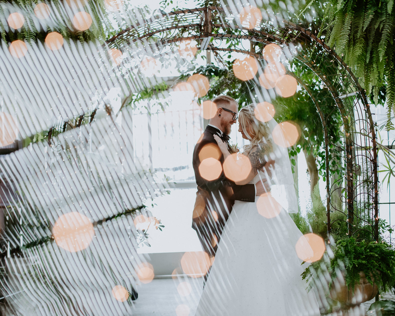 Double exposure of lights and a wed couple dancing
