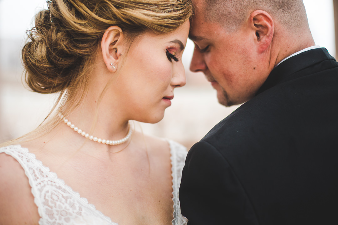 Closeup of bride and groom head to head in an intimate moment
