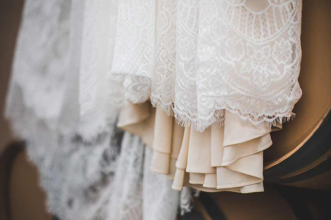 Closeup of boho style wedding dress with lace