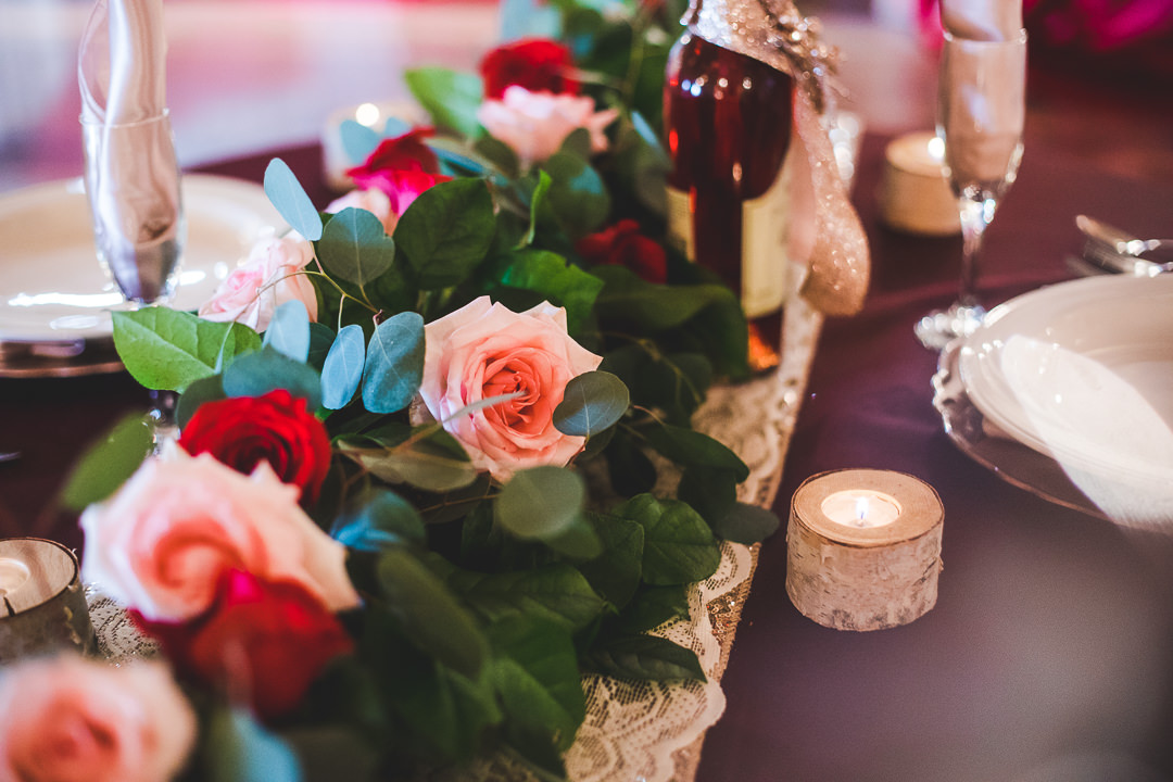Table setting details with flowers and runner