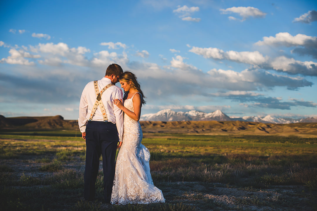 Bride facing groom with mountain above Paonia Colorado behind them