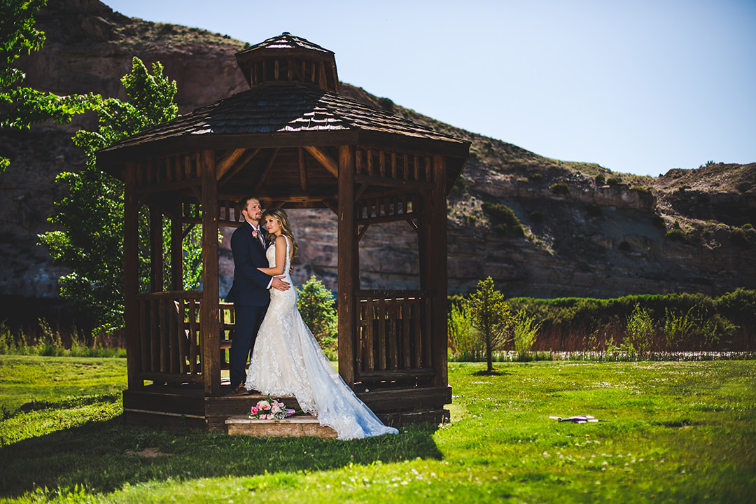 Just married couple standing together in gazebo