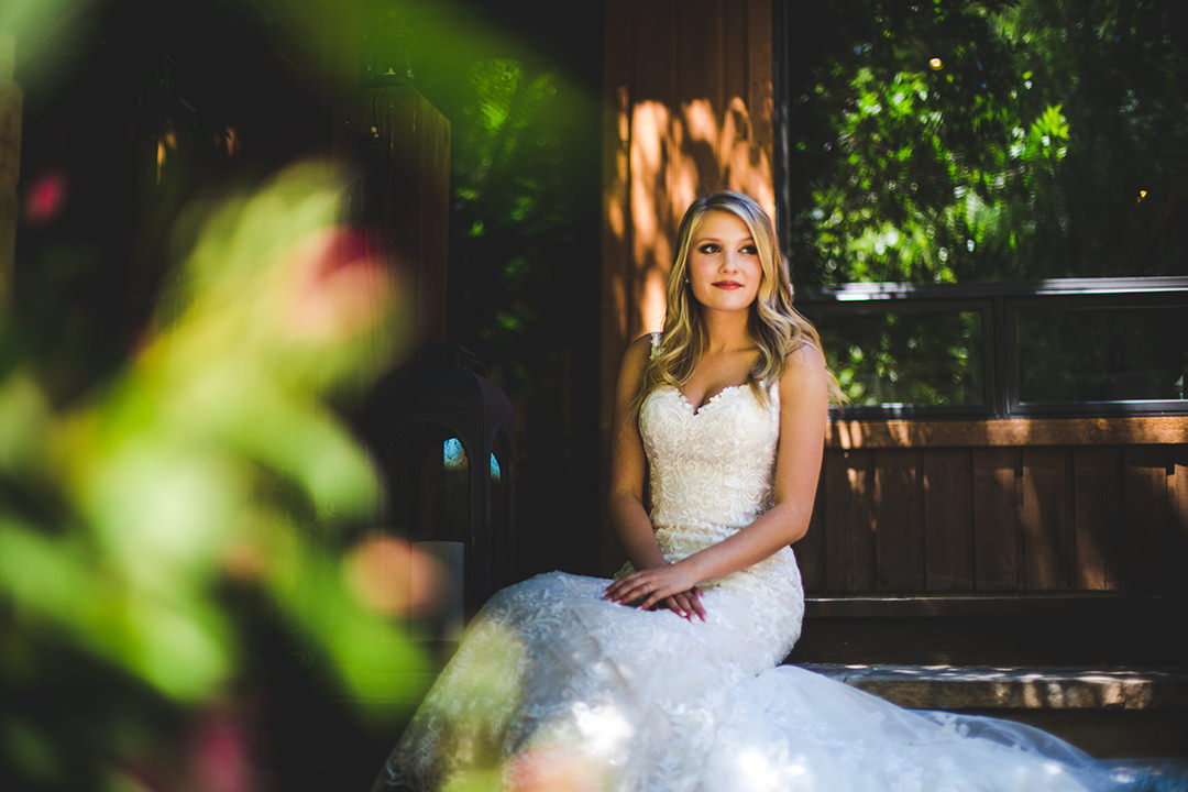 Bride looking away among flowers