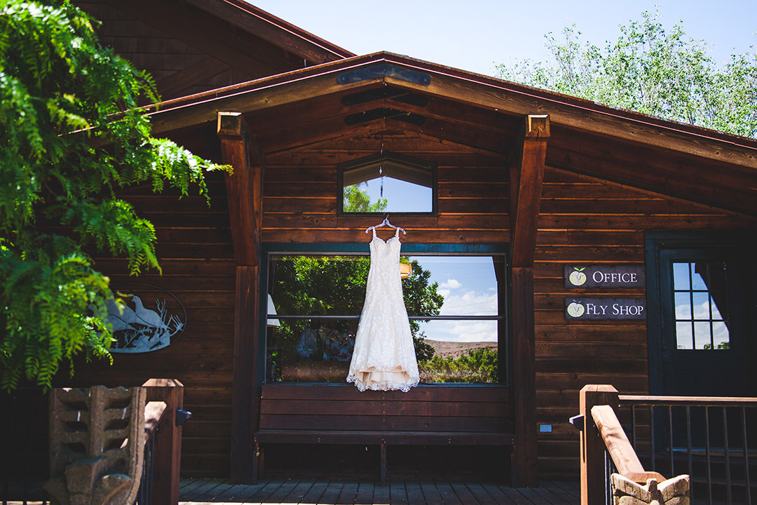Wedding dress hanging in front of the lodge at Black Canyon Anglers