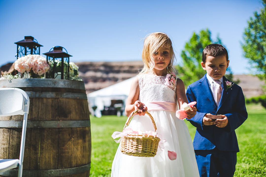 Flower girl and ring bearer taking their jobs seriously before entering the aisle