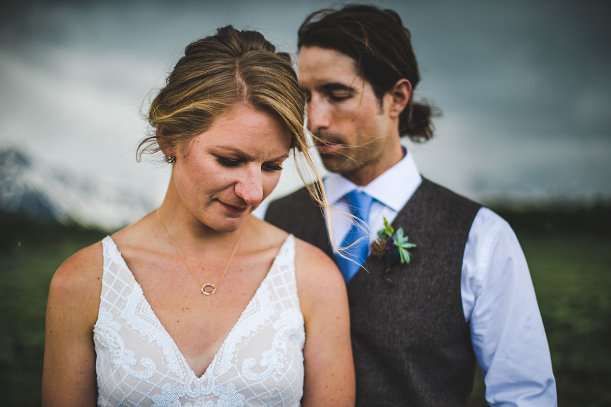 Intimate moment with groom behind bride
