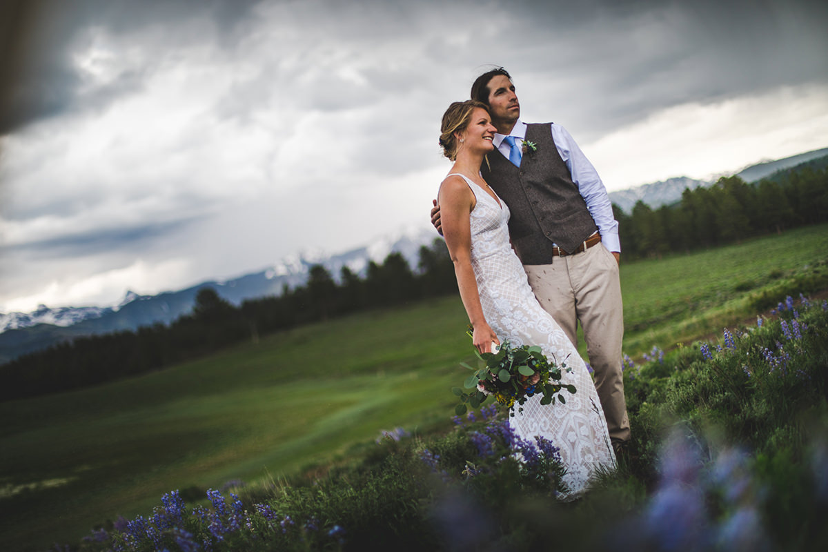 Lupine meadow bride and groom portrait