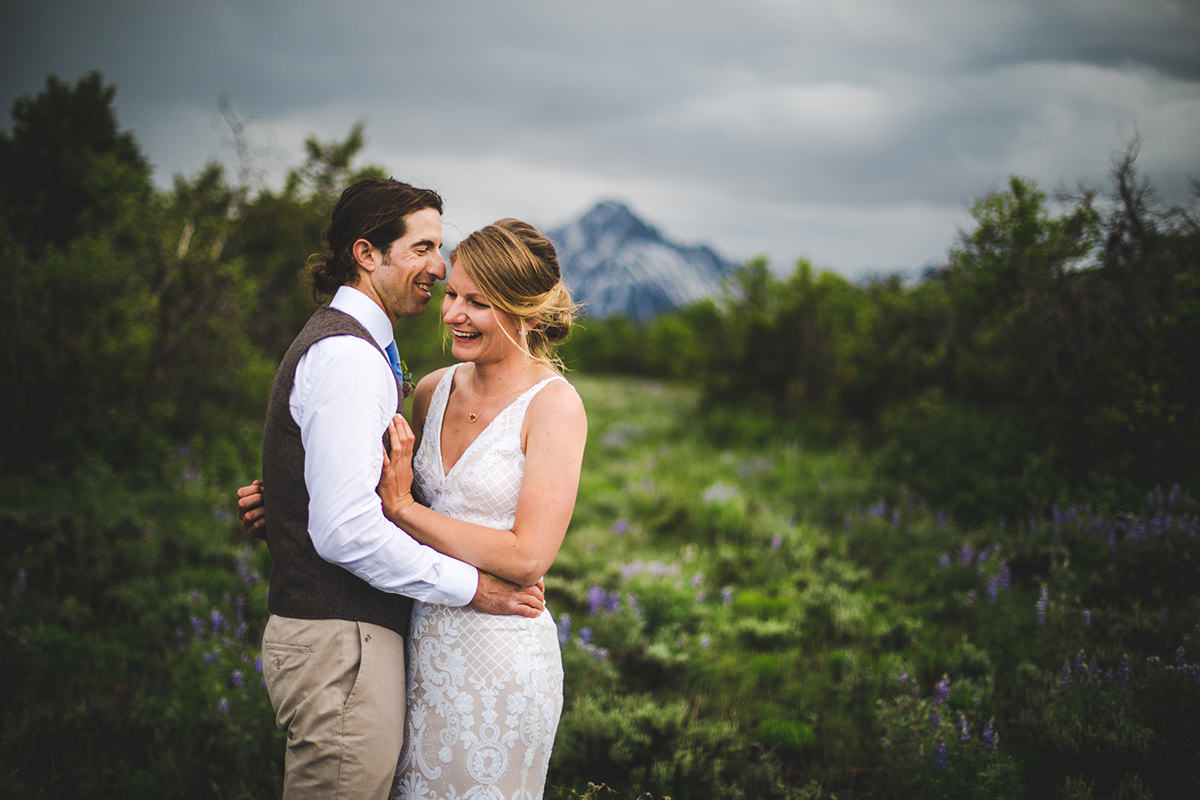 Mount Sneffels in background of bride and groom vibrant portrait