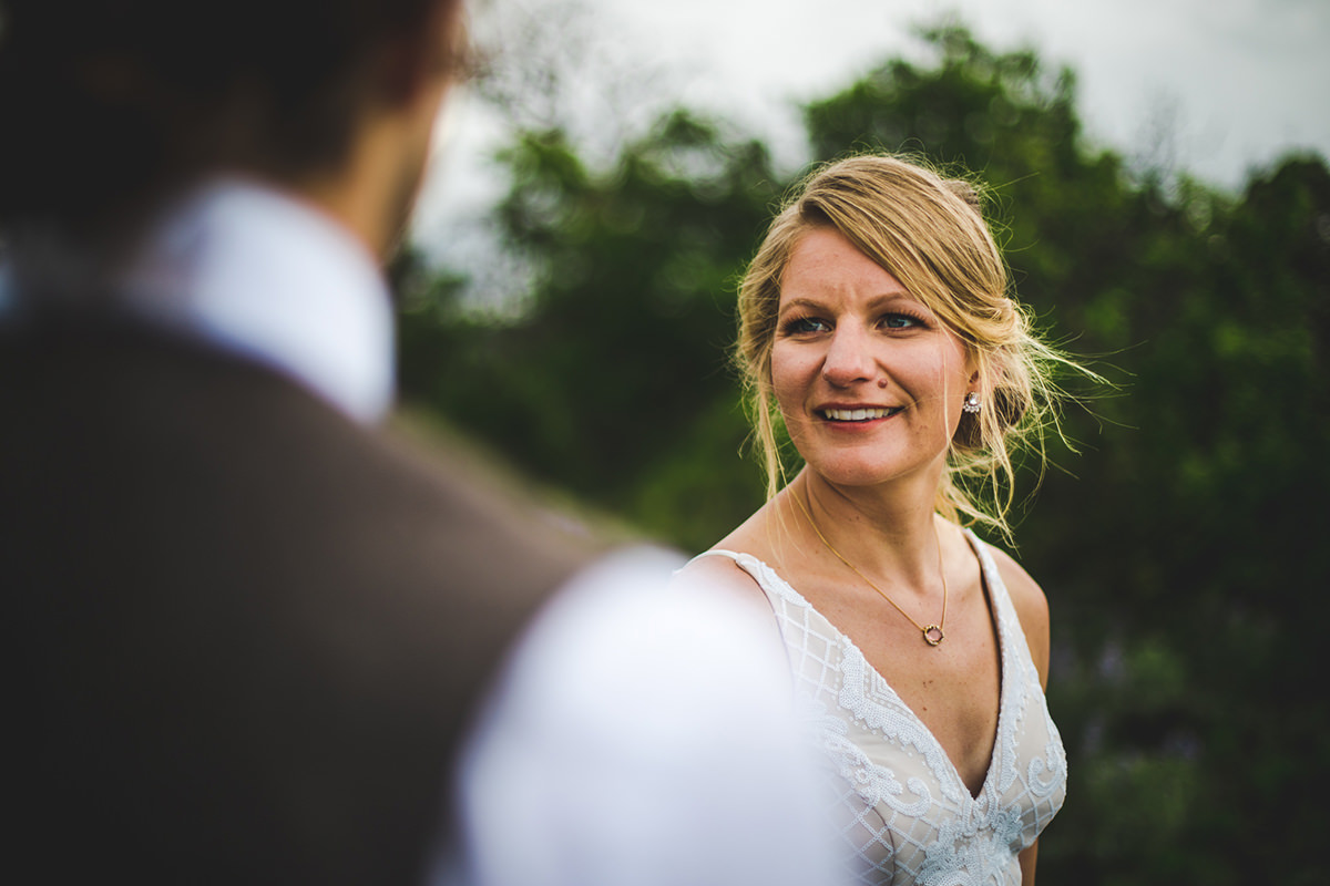 Bride smiling at groom during first look in Ridgway