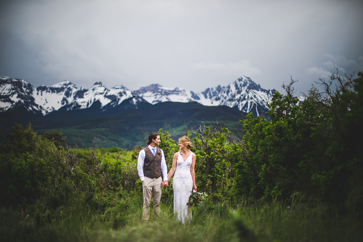 Wide angle of married couple with San Juan mountains in the background