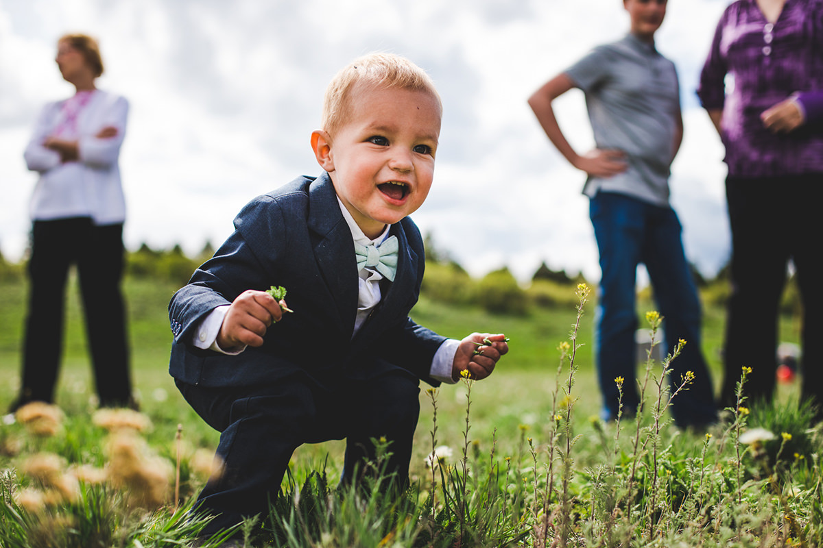 Toddler laughing in grass during reception