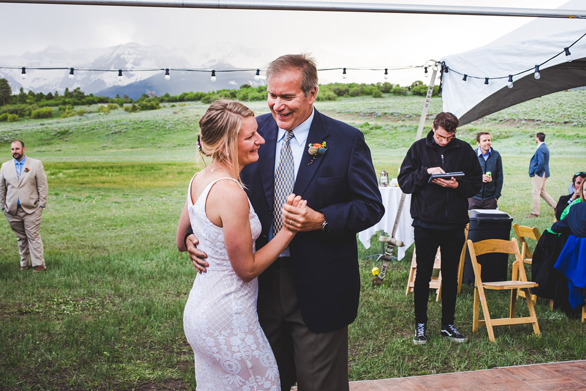 Father daughter dance with the rocky mountains in the backdrop