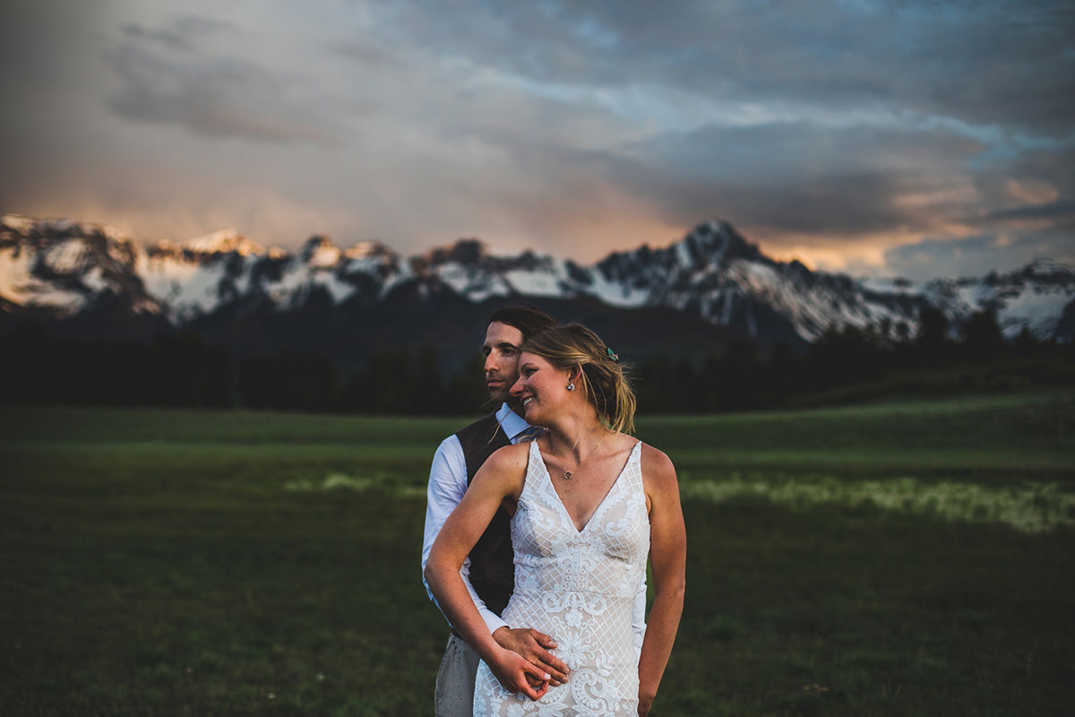 Closeup portrait of man and wife with San Juans in the background