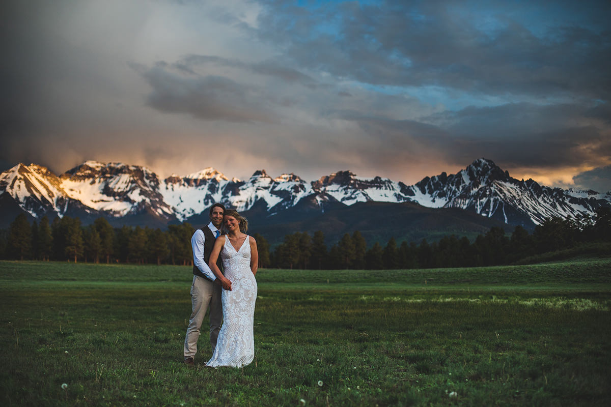 Couple holding each other during sunset on their wedding day