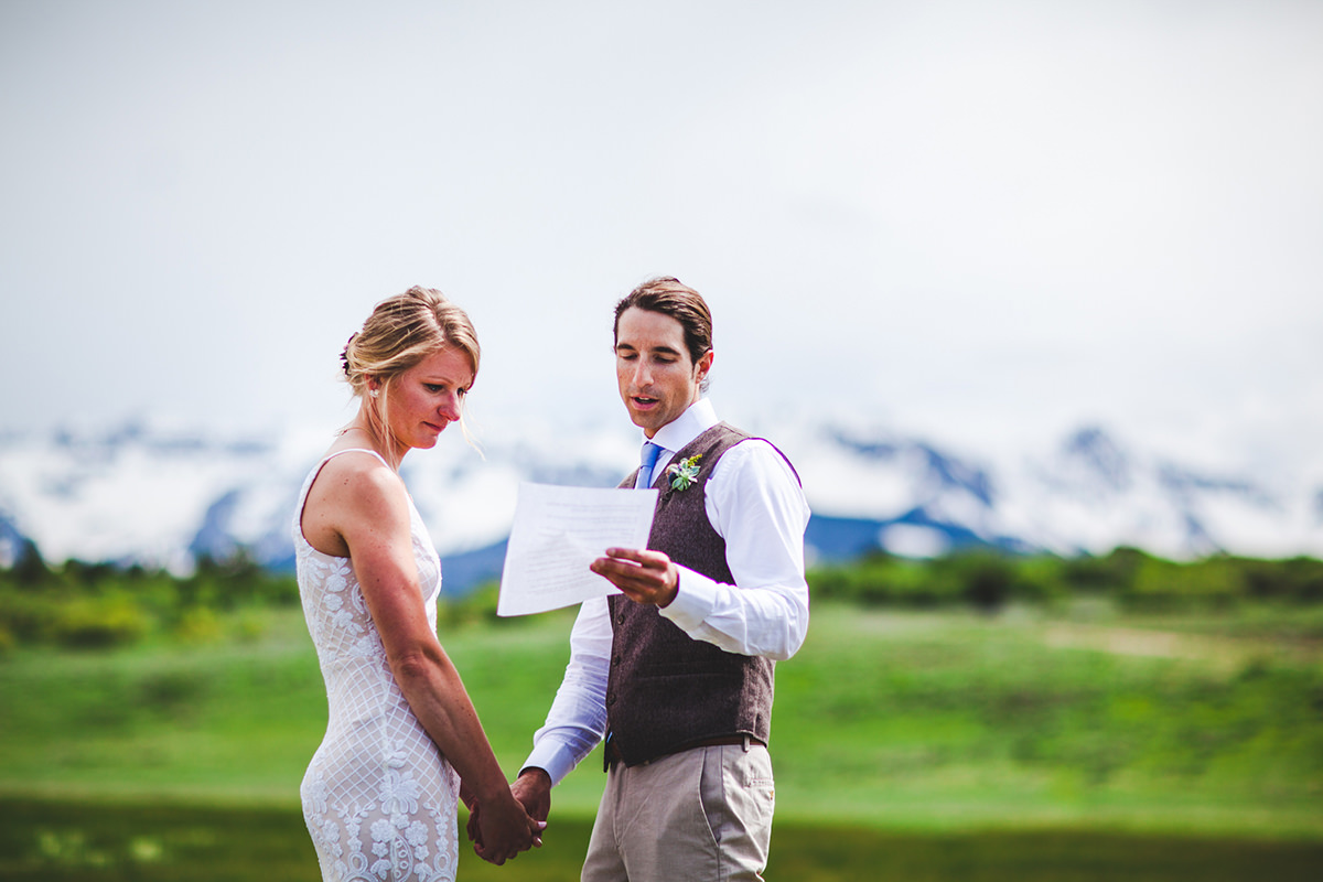 Bride cries as her groom reads vows during their ceremony