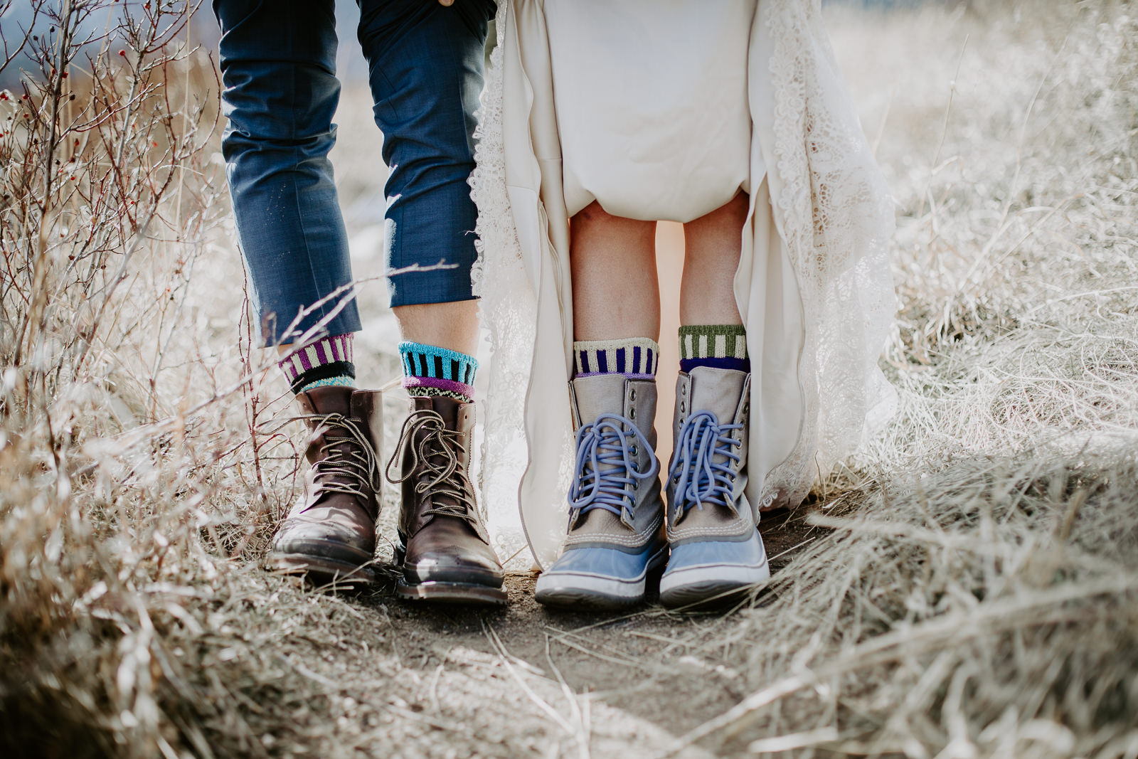 Footwear of bride and groom up close where the bride is wearing snow boots