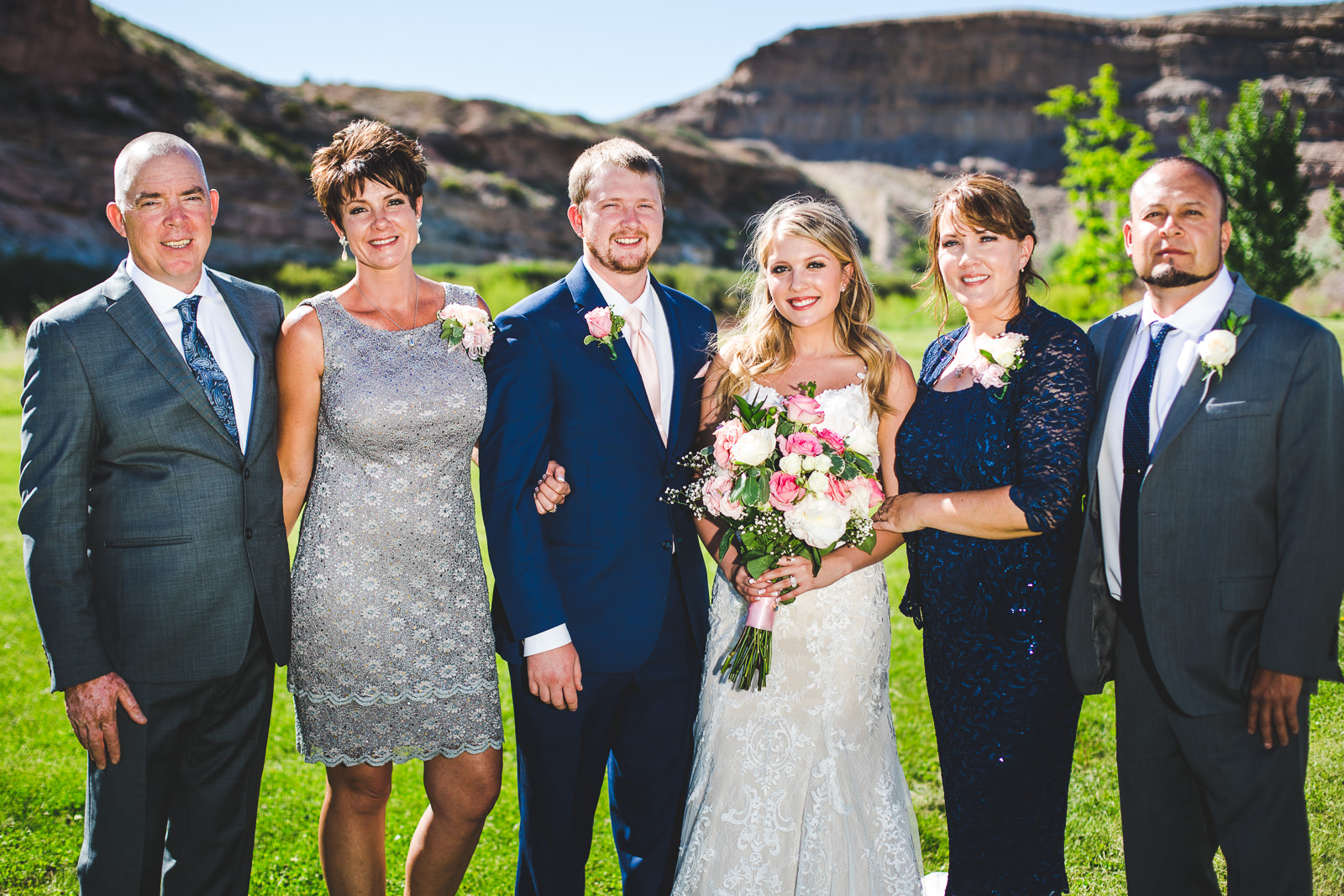 Formal group photo of bride and groom with their parents