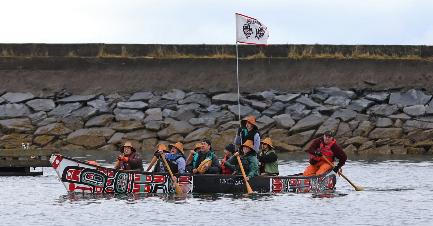 Singing and drumming while paddling into the harbor.