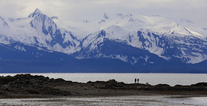 A family explores the point at Bridgett Cove.