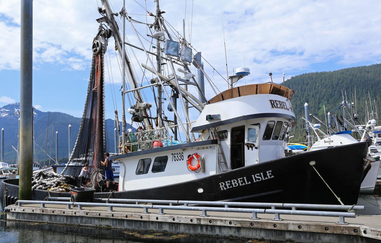 Rebel Isle seiner seine fishing boat Petersburg southeast Alaska harbor dock working net mending