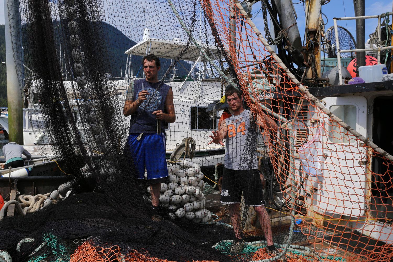 Men working seine net on REBEL ISLE Petersburg Alaska southeast  commercialfishing boat fishermen